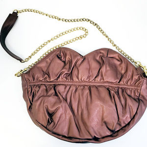 Selena Gomez Brown Lips with Golden Chain Purse